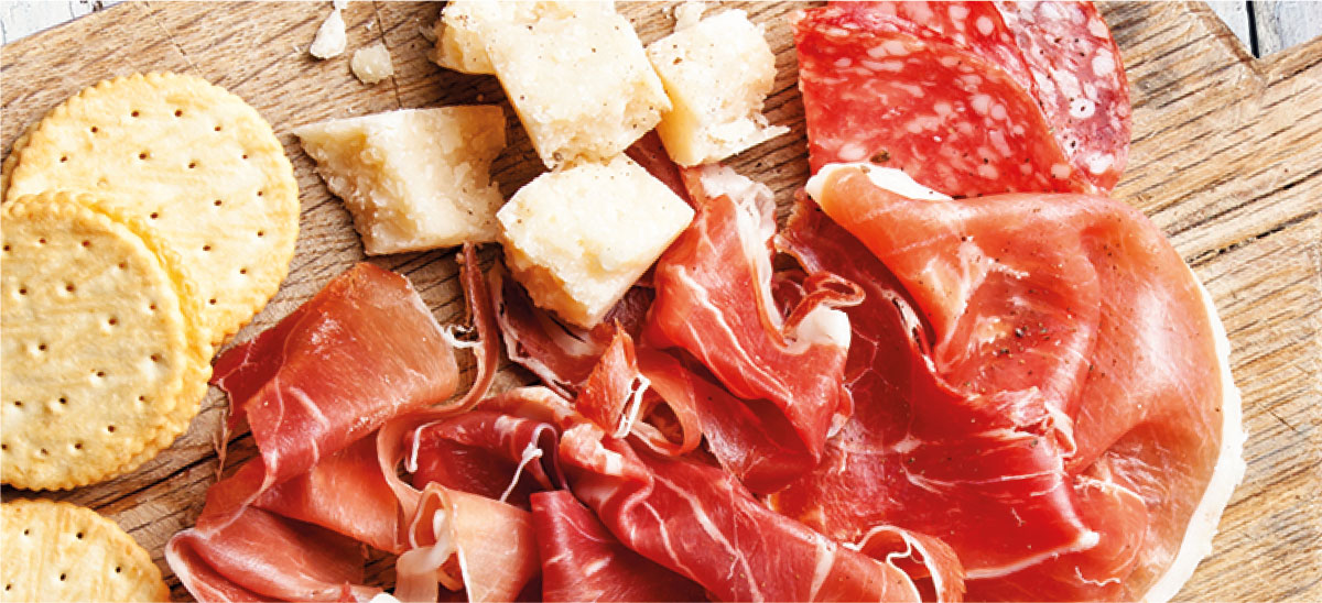 Charcuterie, Cheese, and Crackers on a Wooden Chopping Board