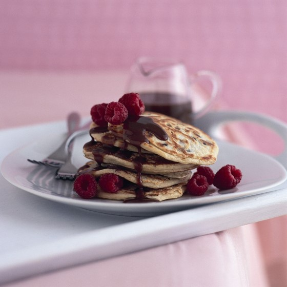 Pancakes with raspberries and chocolate syrup