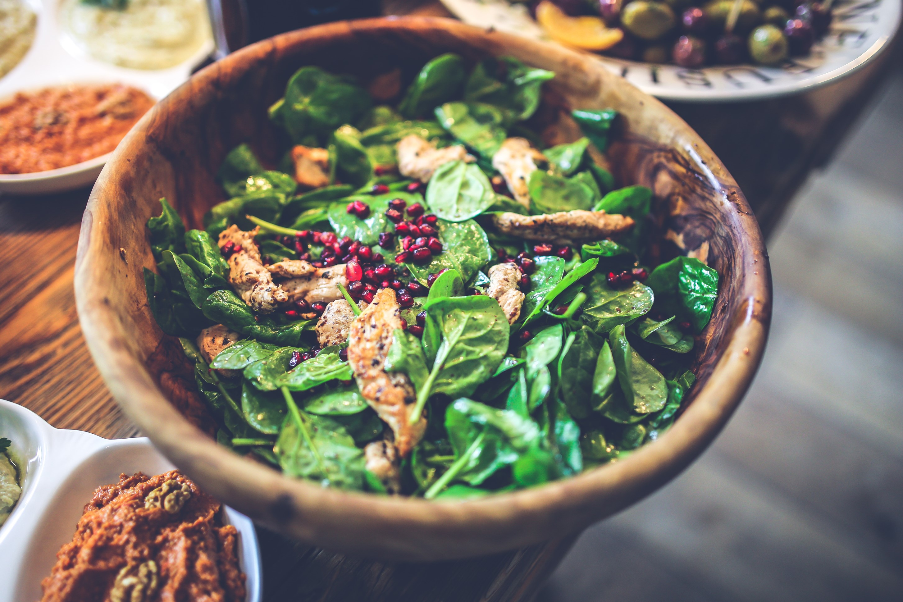 salad with chicken strips, leaves. and pomegranate
